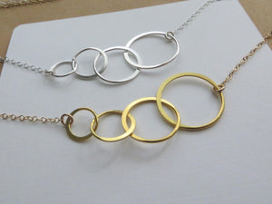 Four rings for four decades necklace - RayK designs