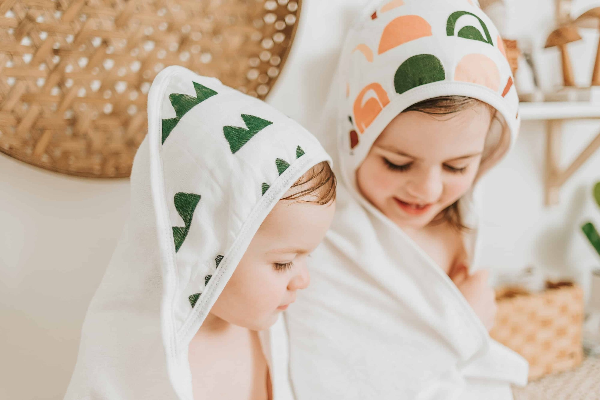 toddlers wearing bamboo hooded towels