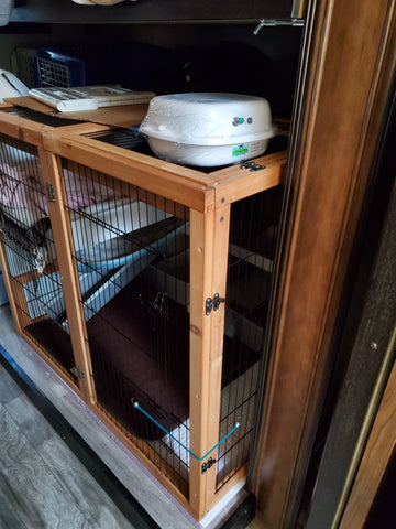 Purrified Air filter on ferret cage in mobile home.