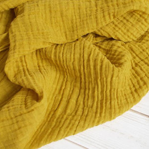 The Sugar House Classic Muslin Swaddle in Mustard