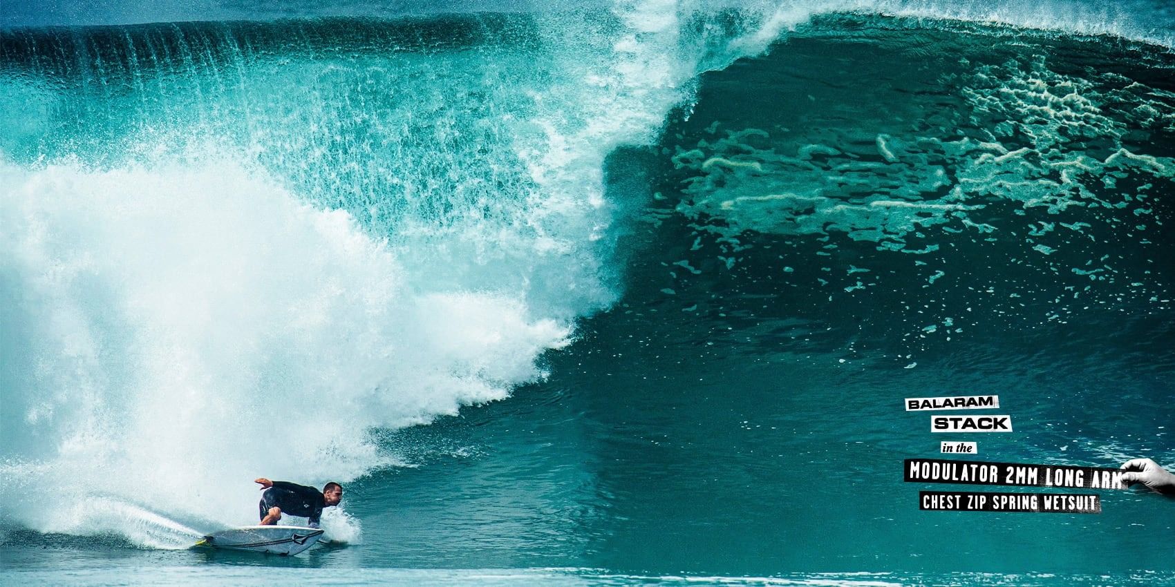 balaram stack surfing wave in the Modulator 2mm Long Arm Chest Zip Spring Wetsuit