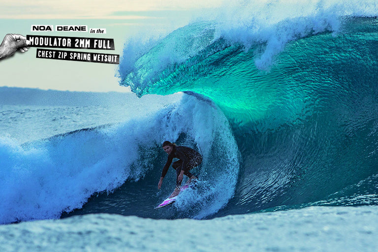 noa deane surfing wave getting barreled in the Modulator 2mm Full Chest Zip Spring Wetsuit