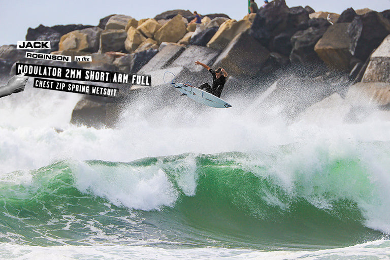 jack robinson puntin getting air off wave surfing in the Modulator 2mm Short Arm Full Chest Zip Spring Wetsuit