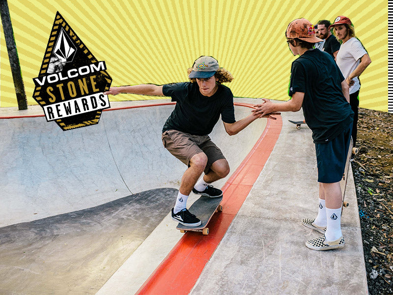 A group of skateboarders riding in a skate park, promoting the Volcom Stone Rewards program.