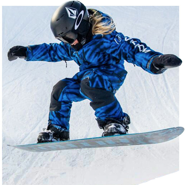 Youth snowboarder riding down the mountain