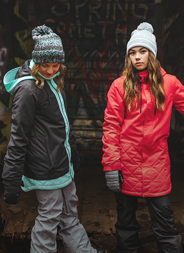 Two females wearing Volcom snow gear