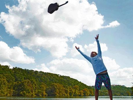 Volcom ambassador throwing a guitar in the air