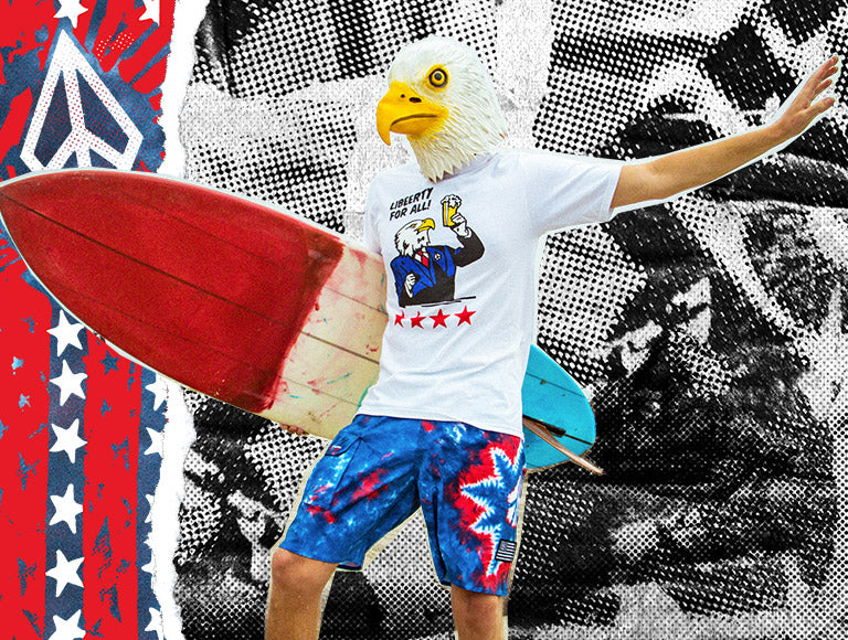 A surfer wearing an eagle head mask, wearing apparel from Volcom's Froth of July collection