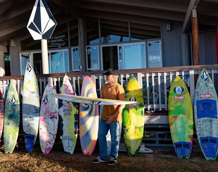 Noa Deane with surfboards