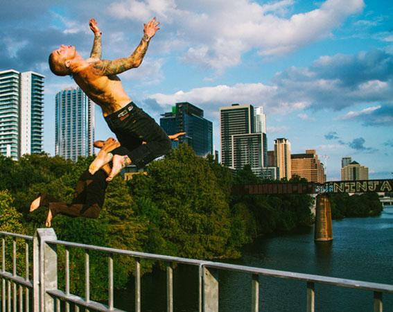 Volcom ambassadors jumping off a bridge