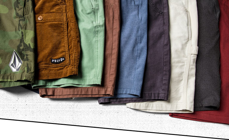 fabfac3bbe8 Nine Volcom shorts laid flat on one another that are various lengths.