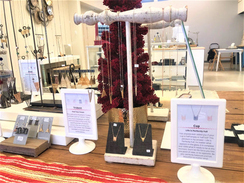 Jewelry on display at the OSJ Store with Mantra displays
