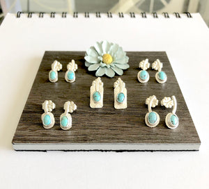 Head on view silver turquoise sprout stud earrings