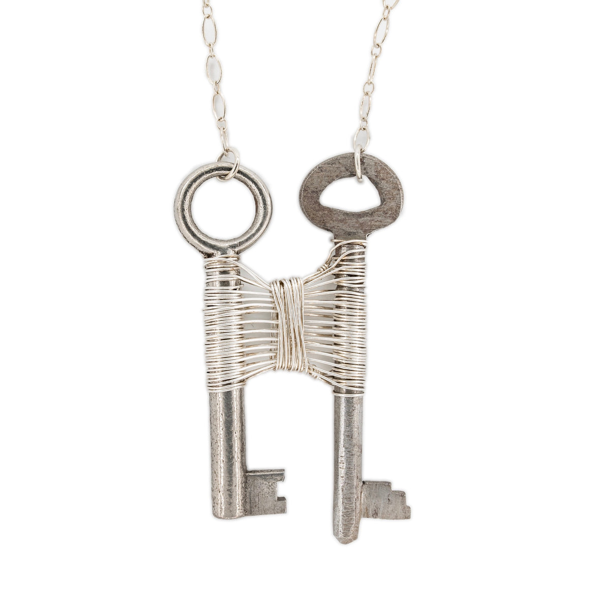 Woven Silver Vintage Skeleton Key Pendant on Silver Necklace by OSJ in Tucson Arizona