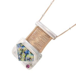 tube set pink tourmaline with purple and yellow fire opal set in silver with woven rose gold bridge pendant by OSJ in Tucson AZ