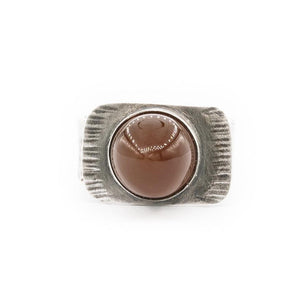hand textured oxidized silver ring with bullet orange Oregon fire opal by OSJ in Tucson Arizona