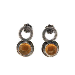front view of Oregon fire opal stud post earrings by Original Sin Jewelry in oxidized silver with radiant texture