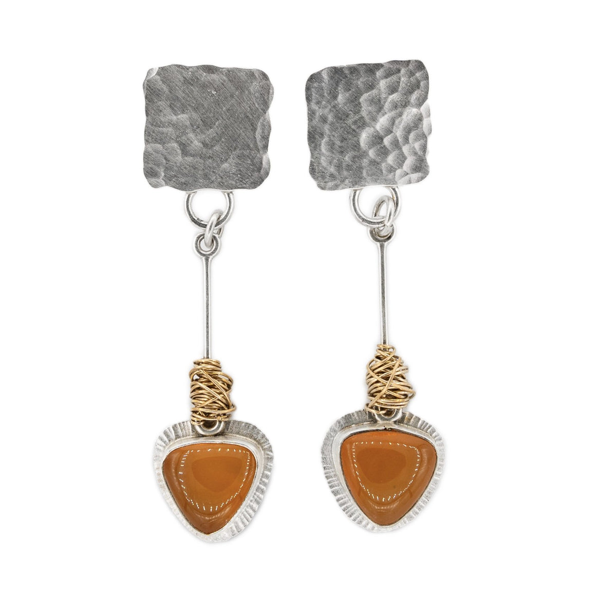 hammered silver post earrings with orange Oregon fire opal pendulum and gold nest by Original Sin Jewelry