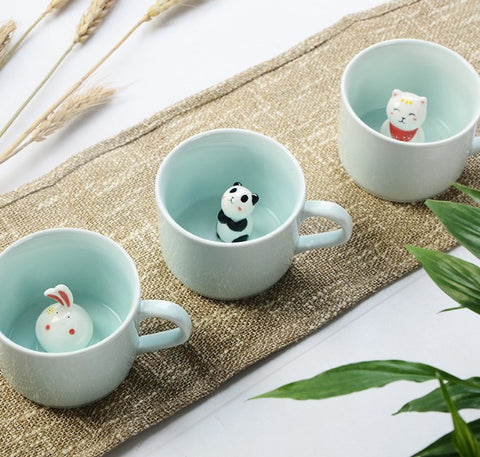 Cute 3d cat, panda, and bunny in mug