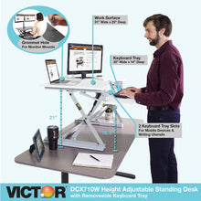 DCX710W - High Rise™ Height Adjustable Standing Desk with Keyboard Tray, White