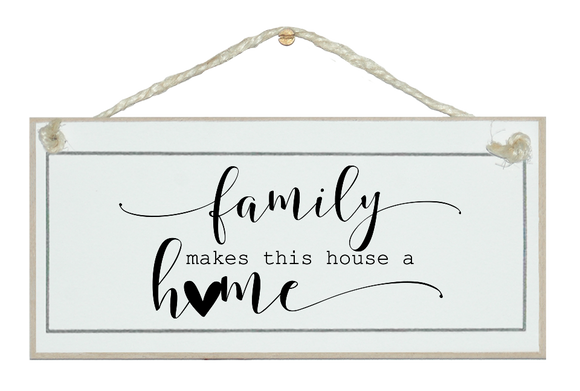 Family makes  this house a home. Sign.