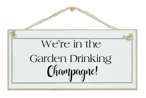 In the garden Drinking Champagne Sign