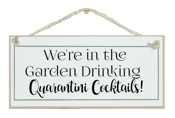 In the garden drinking Quarantini Cocktails sign