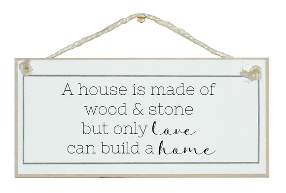 House, wood and stone, love a home. Sign.