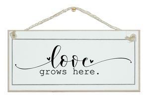 Love grows here. Sign.