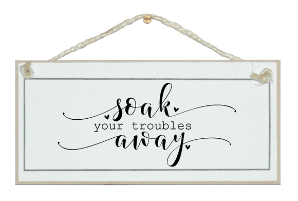 Soak your troubles away. Sign.