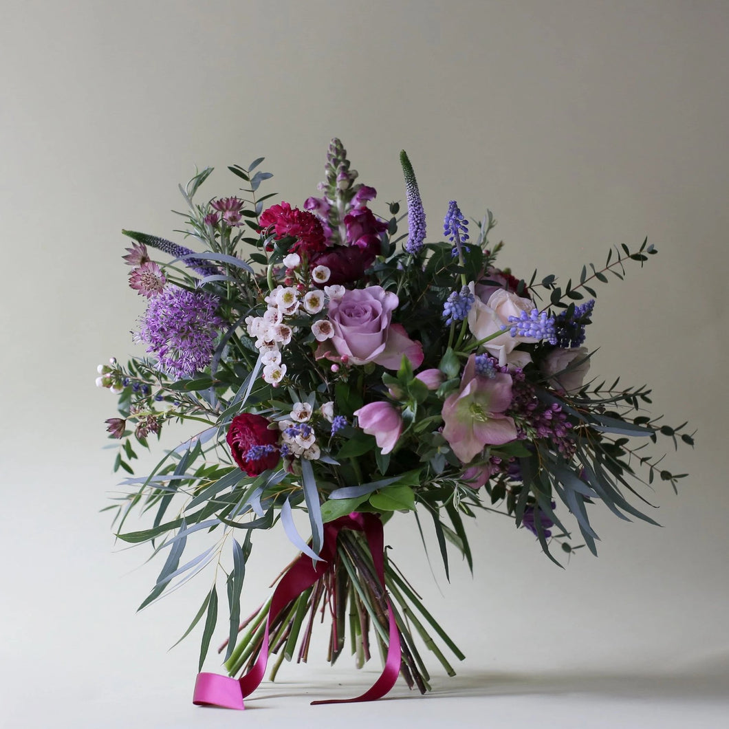 A Catkin & Pussywillow favourite combination bringing all of the colours and scents of an English Country Garden into your mum's home. Created with memory lane & double cream vendella roses mixed with rosemary, lavender & mint along with clematis, ranunculus, hellebore, astrantia roma, lilacs, strawberry scabious, veronica, muscari & waxflower.