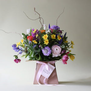 A literal abundance of Spring in one beautiful rainbow coloured bunch,  this bouquet will light up your mum's day. Created with scabious, narcissi, tulips, ranunculus, iris, lilacs, stocks, anemones & hyacinths with hellebore, craspedia & curly willow. The picture shows an example of the medium bouquet.