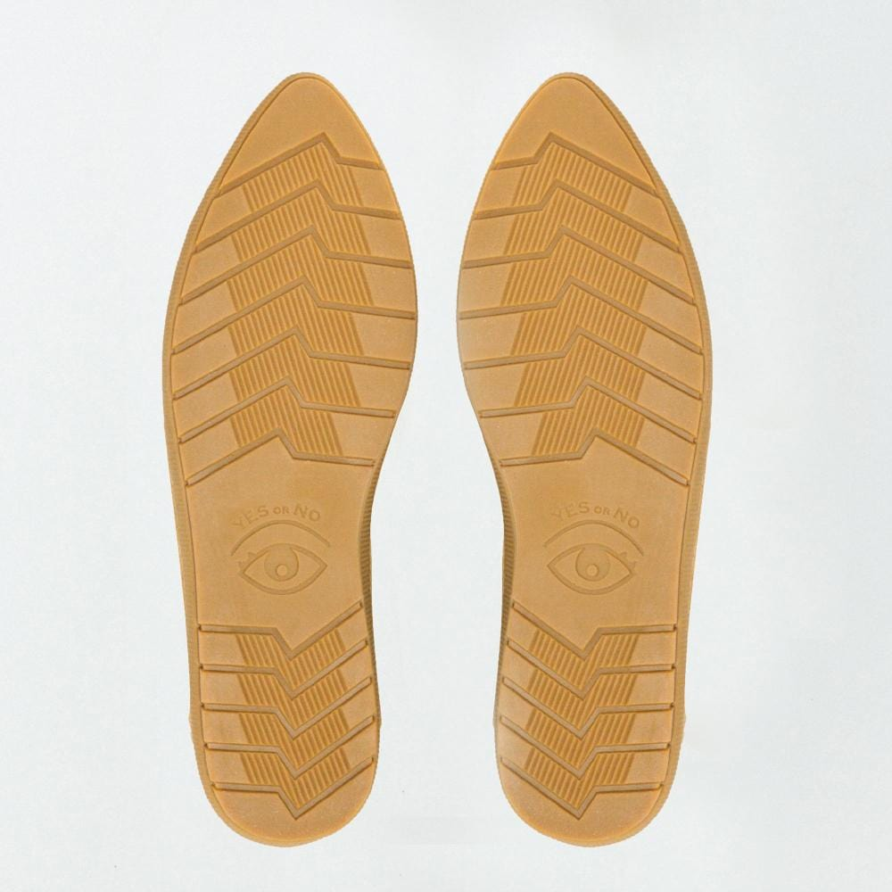 Bottom view of Vision Quest Shoes.  The bouncy rubber outsole in gum color, outsoles have tread patterns and one eye on each shoe creating a pair of eyes together.