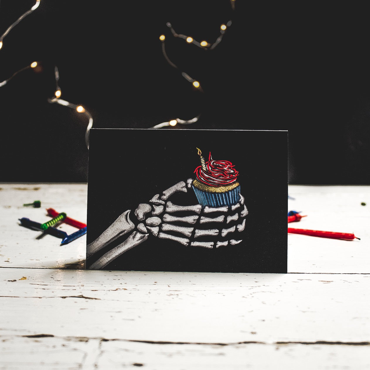A6 Black Birthday Card Skeleton Holding a Cupcake with Candle, Illustration by Wayward