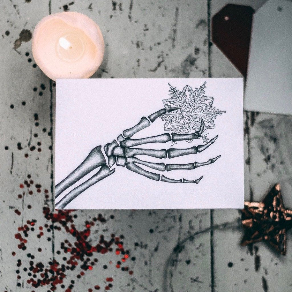 Skeleton with Snowflake Alternative Christmas Card