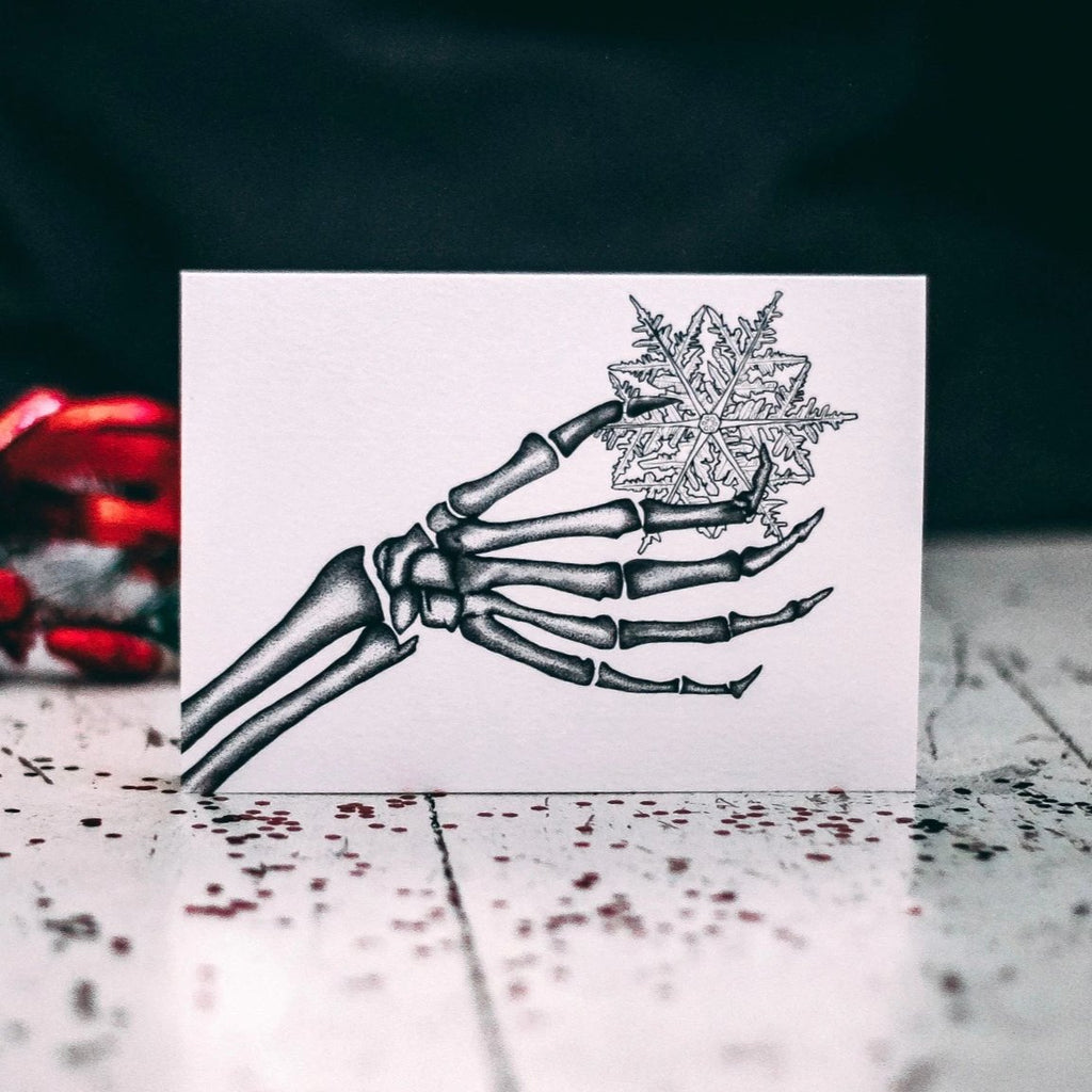 A6 Greetings Card with snowflake skeleton hand illustration by Wayward