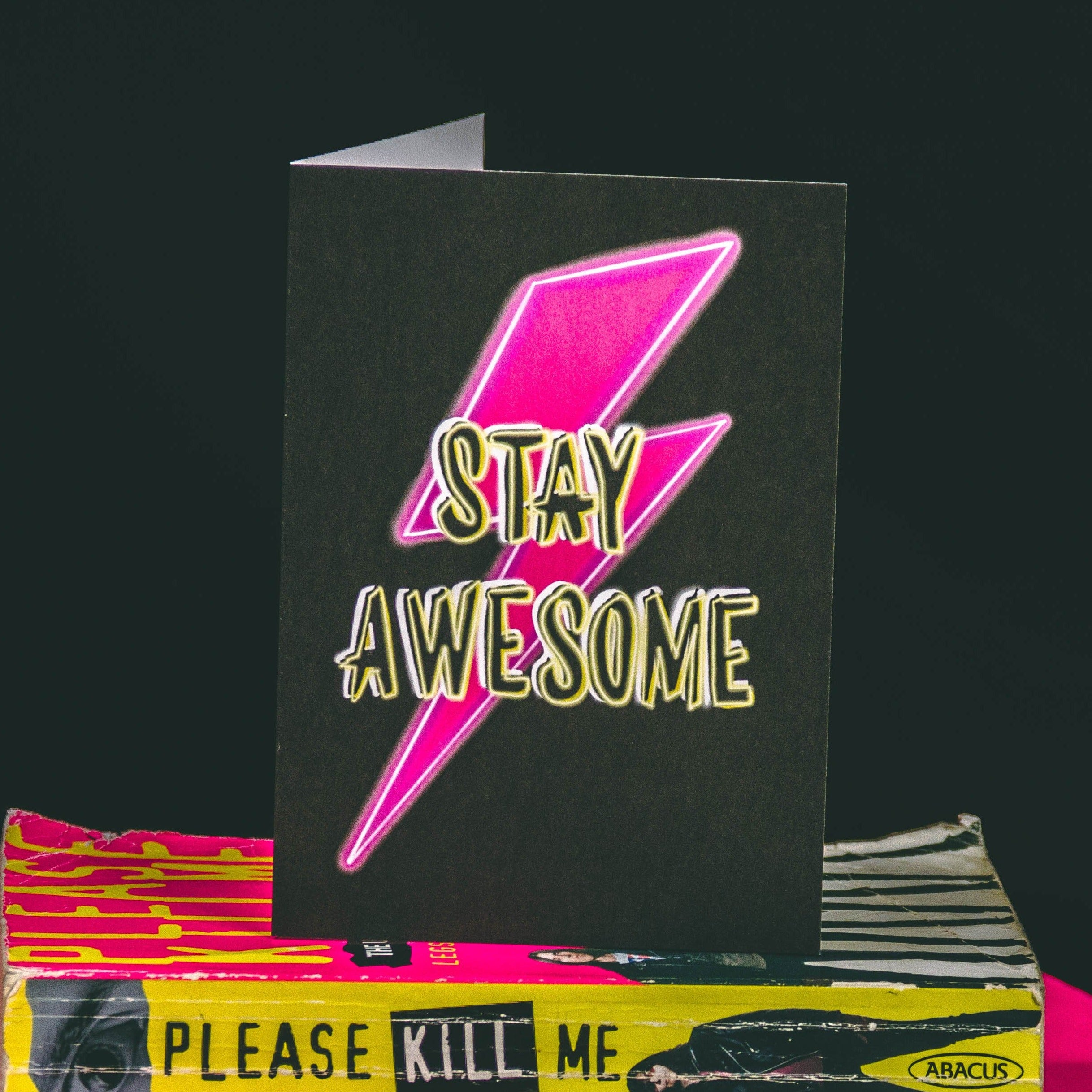 A6 Black Greetings Card With Pink Bowie Lightening Bolt and Stay Awesome Slogan by  Wayward