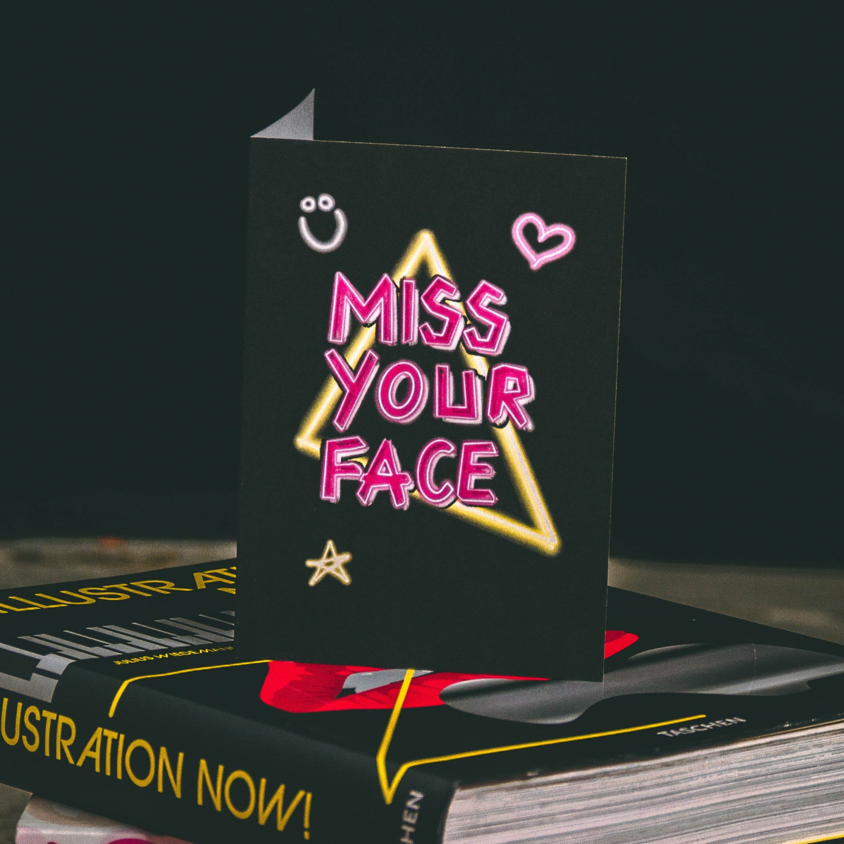 Black A6 Greetings Card with Pink Miss Your Face Neon Slogan Design  - By Wayward