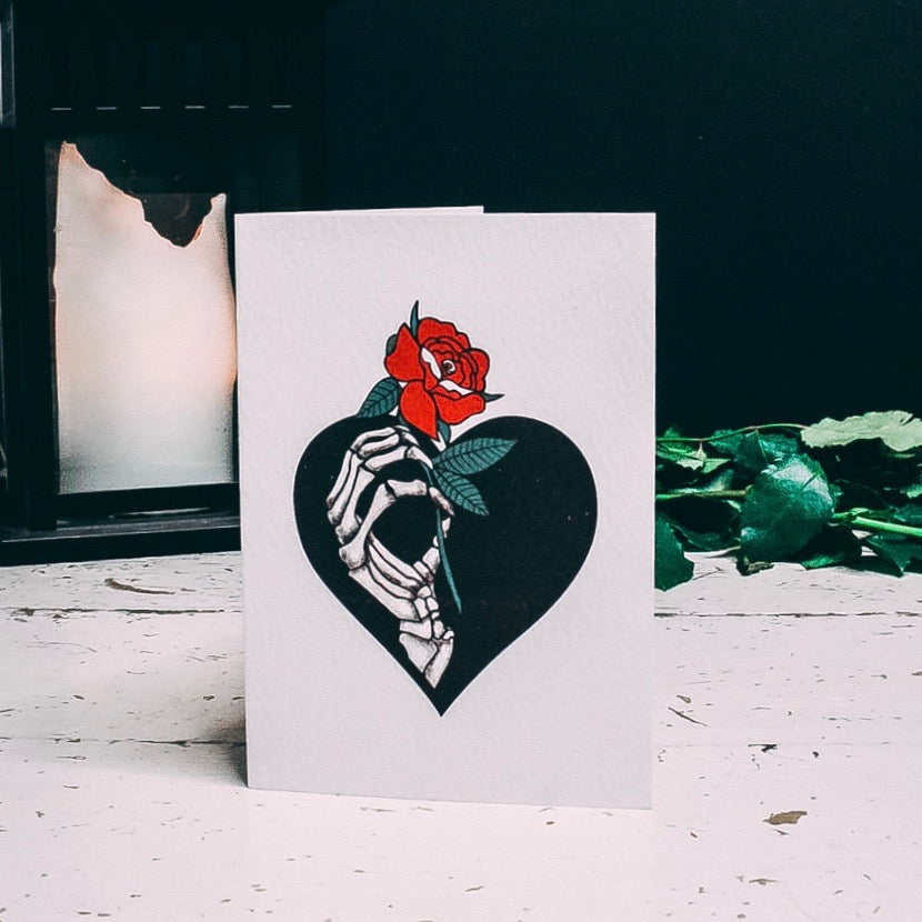 Skeleton Hand Holding red rose illustrated A6 Greetings card by Wayward
