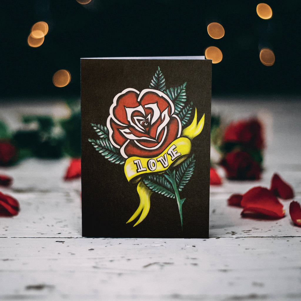 Rose with tattoo banner A6 greetings card by Wayward