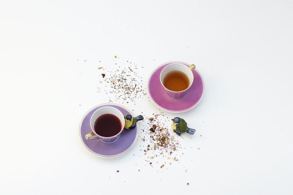 Pink and purple cups with herbal tea