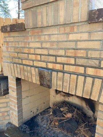cleaning results removing smoke and soot from brick and stone fireplace