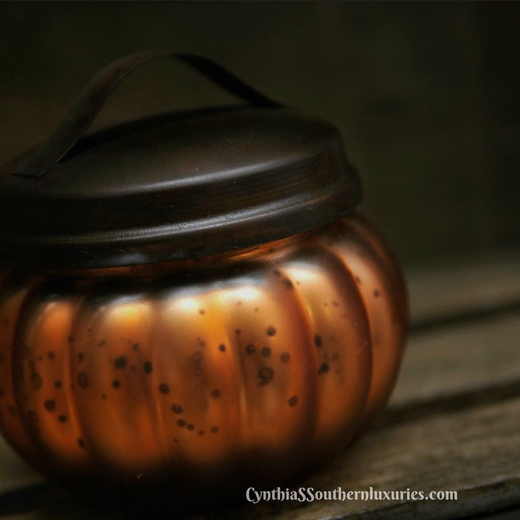 Pumpkin shaped candle