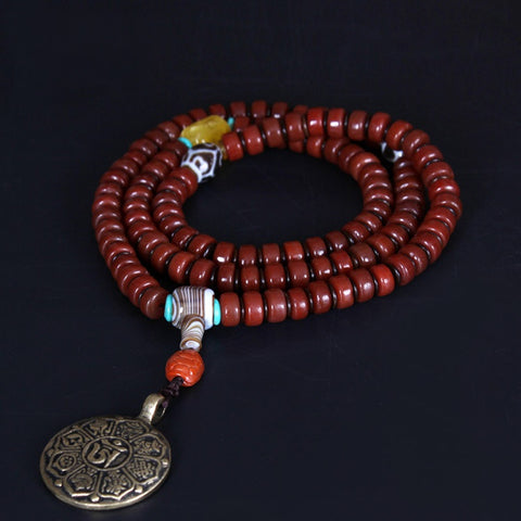 Red Agate Om Medallion Tibetan Prayer Beads | MANTRAPIECE