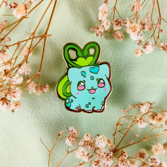 blobbysaur surrounded by flowers