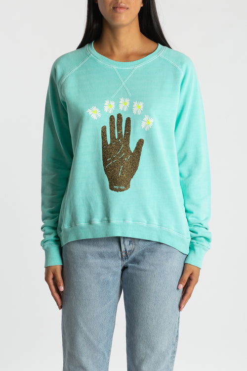 The Belle Sweat in mint lagoon featuring glitter palm and hand drawn daisies.