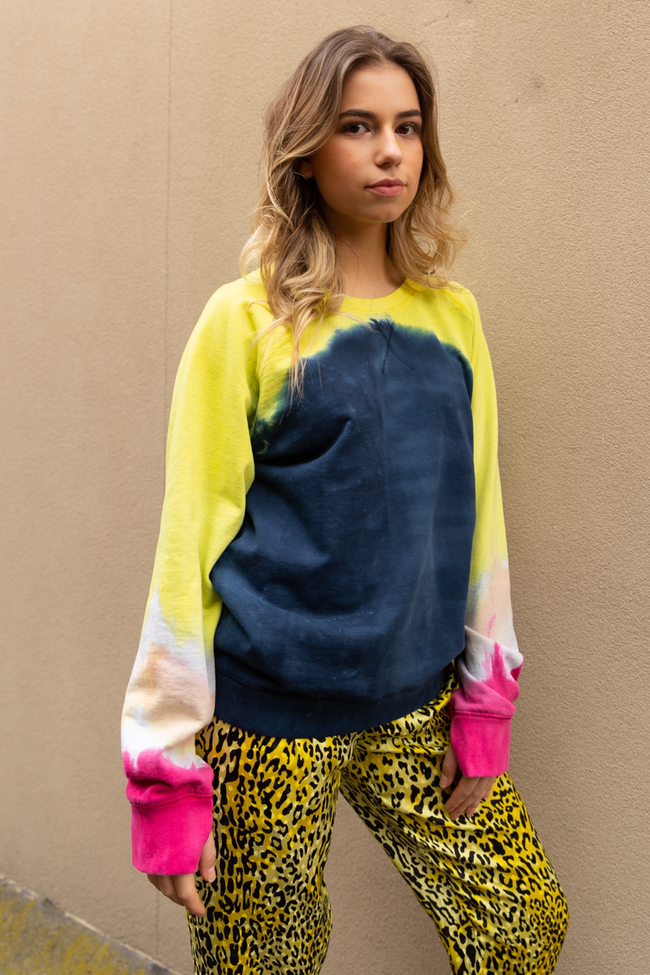 The Mooki sweatshirt paired with yellow leopard print silk pants.