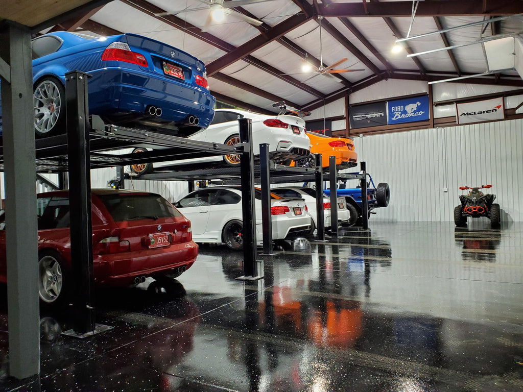 Ultimate M Garage - Floor View of BMWs on Lifts