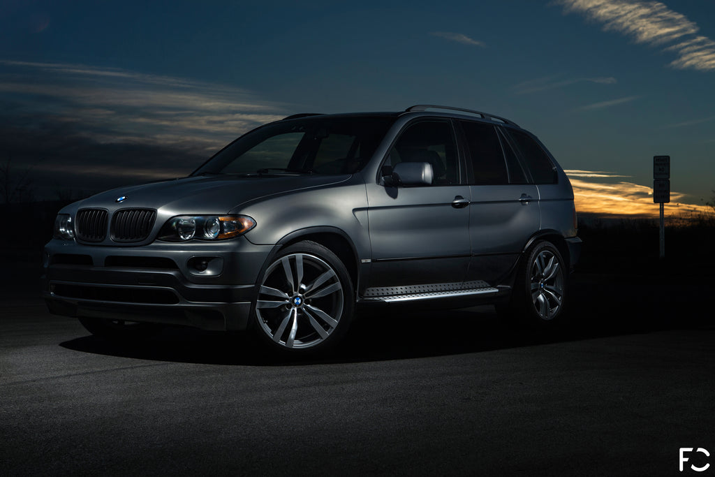 BMW E53 X5 angle view at dusk - stratus grey metallic
