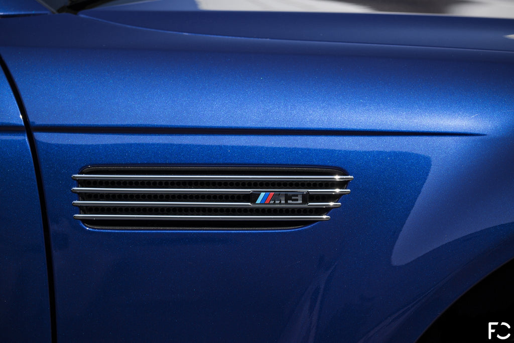 Interlagos Blue E46 M3 OEM chrome fender grille close up